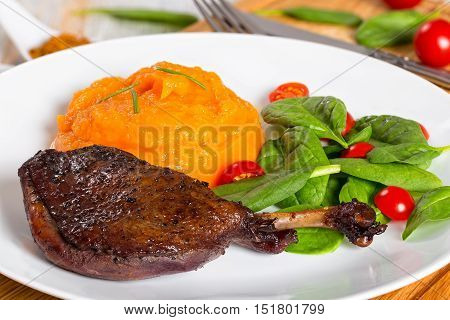 Grilled Duck Legs Marinated In Red Wine With Pumpkin Puree