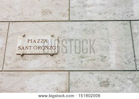Plate affixed to the wall for Sant'Oronzo Square in Lecce cultural and tourist landmark