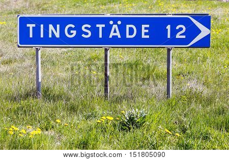 Signpost with distance to the village Tingstade in the Swedish province of Gotland.