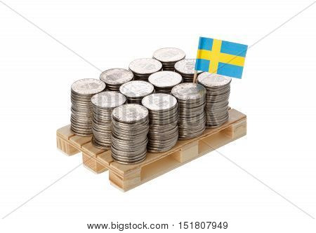 Swedish flag on the pallet with the Swedish coins isolated on white background.