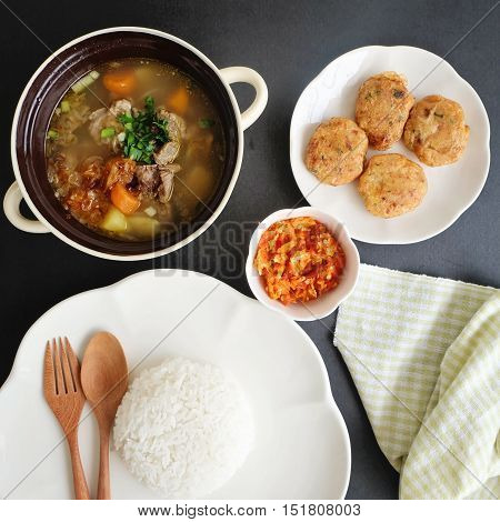 Traditional Indonesian meat soup and fried mesh potato