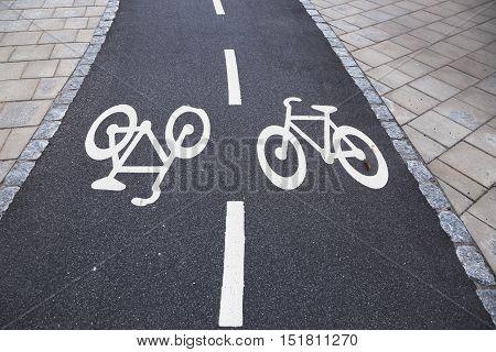 Bicycle lanes marked in asphalt in Sweden.