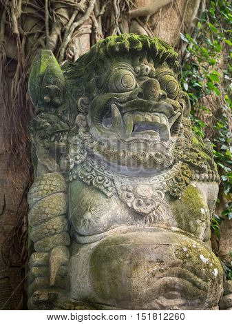 A typical old stone carving in the Ubud Monkey Forest in Bali, Indonesia.
