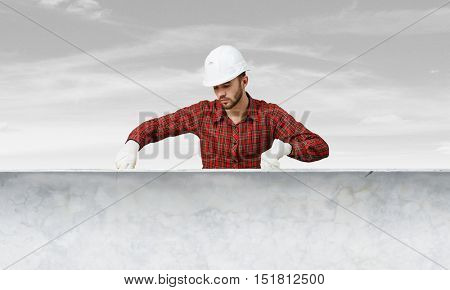 Builder man with level . Mixed media