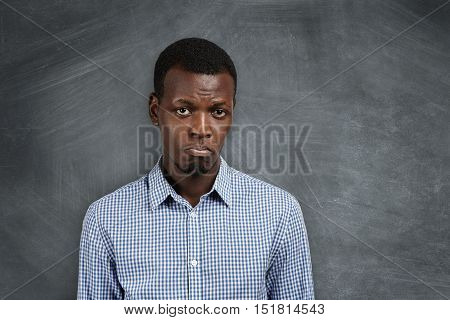 Unhappy And Sad African Student Grimacing, Displeased With His Failure On Exams. Young Dissatisfied