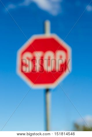 Out of focus photo of Stop sign