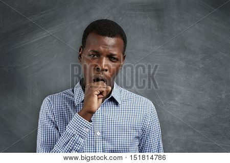 Young African Teacher Looking Tired And Sleepy, Yawning, Covering His Mouth With, After Sleepless Ni