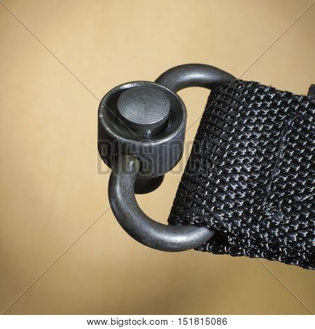 Metal unit that is used to quickly attach a sling to a rifle