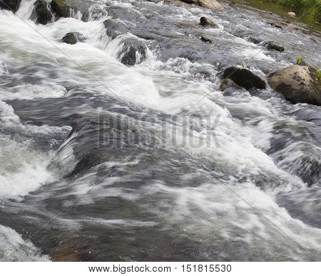 Wilson Creek boiling up as it rushes over boulders in North Carolina