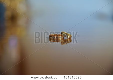 two golden wedding rings in the celebration day