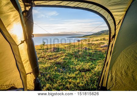 Camping in the arctic under the midnight sun