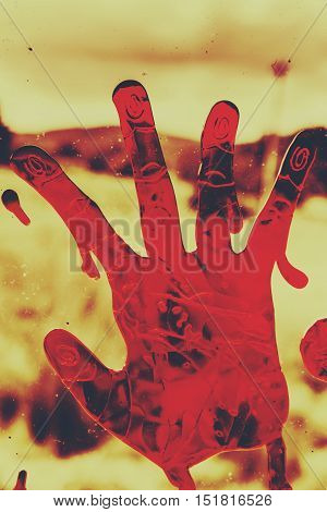 Bloody Halloween palm print left by a beseeching victim in the throes of death