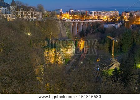 Panoramic view on Luxembourg viaduct or old bridge, Petrusse valley and the city center of Luxembourg at twilight