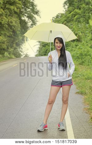 sport girla jogging when it rains,sport girl.
