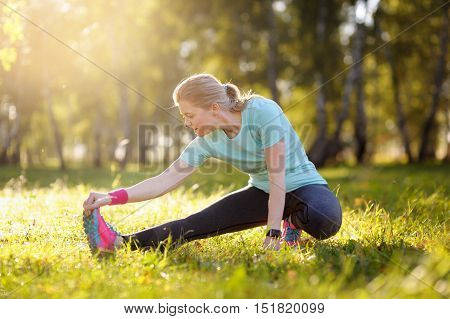 Running stretching - runner wearing smartwatch. Training and stretching.