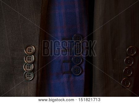 Buttons on a sleeve of a man's suit. Selective focus