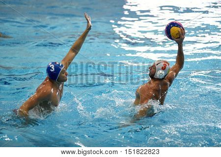 KAPOSVAR, HUNGARY - OCTOBER 5: Oliver Kovacs (white 3) in action at a Hungarian national championship water-polo game between Kaposvar (white) and Honved (blue) on October 5, 2016 in Kaposvar, Hungary
