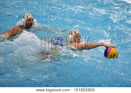 KAPOSVAR, HUNGARY - OCTOBER 5: Norbert Juhasz-Szelei (white 11) in action at a Hungarian national championship water-polo game (white) vs. Honved (blue) on October 5, 2016 in Kaposvar, Hungary