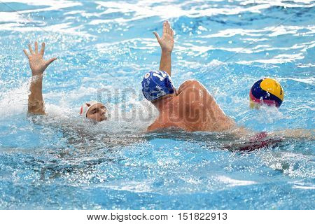 KAPOSVAR, HUNGARY - OCTOBER 5: Adrian Simon (in blue) in action at a Hungarian national championship water-polo game between Kaposvar (white) and Honved (blue) on October 5, 2016 in Kaposvar, Hungary