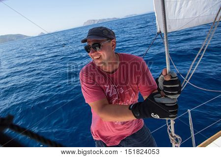 HYDRA, GREECE - OCT 4, 2016: Sailors participate in sailing regatta 16th Ellada Autumn 2016 among Greek island group in the Aegean Sea, in Cyclades and Saronic Gulf.