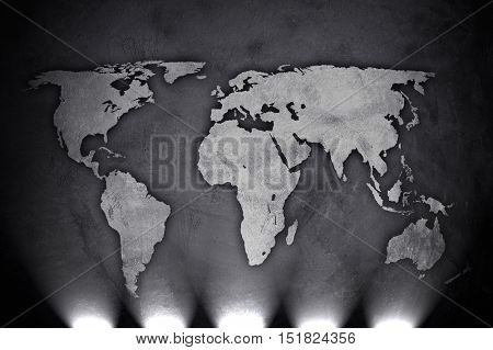 world map on concrete wall with spotlight background
