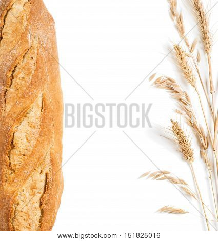 Frame of baguette bread and ears of wheat and oat isolated on white background with copy space. Above view.