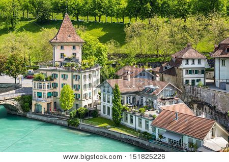 Bern Switzerland - May 26 2016: Houses lining the banks of the Aare river in Bern (Unesco Heritage) the capital of Switzerland.