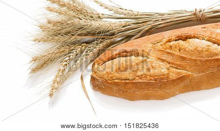 Loaf of baguettes bread and sheaf of wheat isolated on white background.
