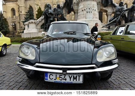 CLUJ-NAPOCA ROMANIA - OCTOBER 15 2016: Vintage cars exhibited during the Retro Mobile Autumn Parade in the city of Cluj Napoca. Event organized by Retro Mobil Club Romania