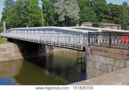 Kronstadt Russia - 10 July 2016: The dock bridge over the canal of Peter the Great outside St. Petersburg Kronstadt. When entering the ship to the dock bridge is put aside