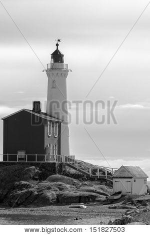 Lighthouse and boat house British Columbia coast Canada