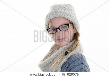 Optician Putting Glasses To Girl At Optics Store