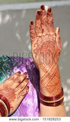 Mehandi on Indian women hands with bangles