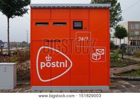 Almere Poort, The Netherlands - Oktober 15 2016: PostNL parcel and letter machine by the side of a public road in the city of Almere.