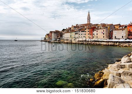 The historic part of Rovinj in Croatia with the Church of Saint Euphemia and the sea.