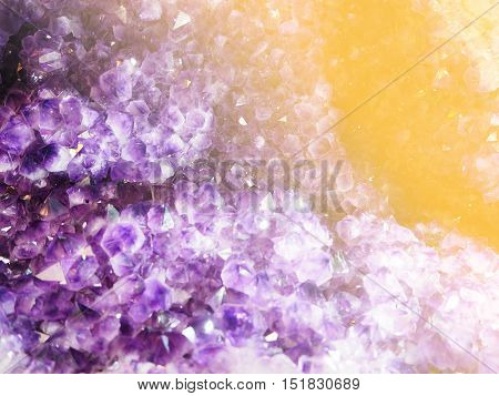 Natural amethyst crystal texture for background with warm filter