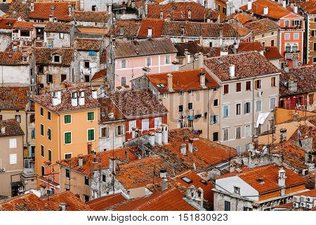 Top view of the stone houses with red-tiled roofs in a European city.