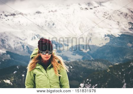 Woman Traveler walking alone Travel Lifestyle adventure concept snow big mountains on background active vacations