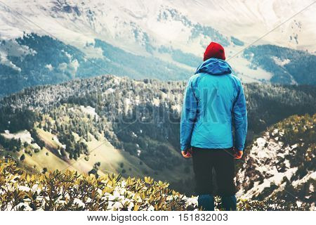 Traveler Man standing alone on mountain cliff Travel Lifestyle aerial view landscape forest adventure vacations outdoor wild nature