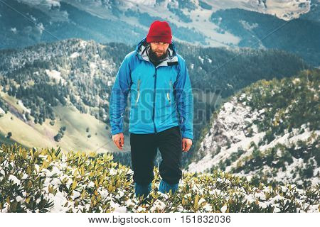 Traveler Man bearded hiking alone Travel Lifestyle aerial view mountains landscape adventure survival concept outdoor wild nature