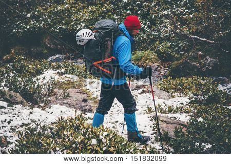 Traveler Man hiking alone in forest with big backpack Travel Lifestyle adventure survival concept outdoor active vacations