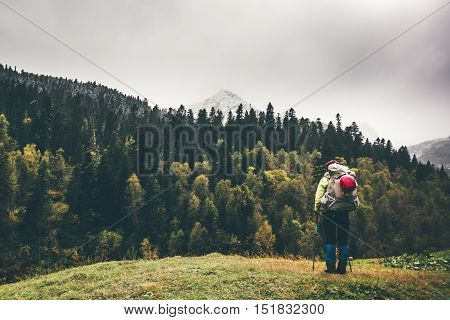 Backpacker enjoying view landscape alone Travel Lifestyle adventure concept mountains forest on background active vacations