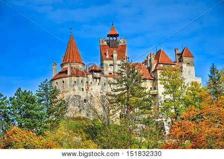 Autumn panoramic view over beautiful Dracula castle in fall season, in Bran town Romania.