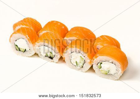 delicious sushi rolls with salmon isolated on white