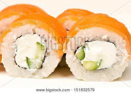 two sushi rolls with salmon closeup isolated