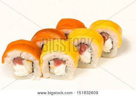 multicolored sushi rolls with fish isolated on white background