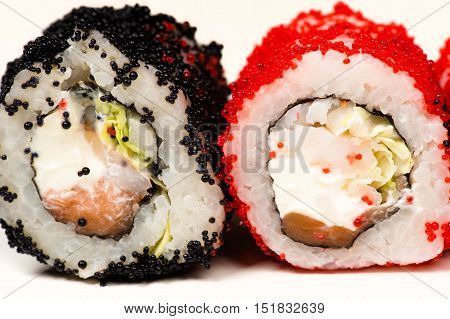 two delicious sushi rolls isolated on white