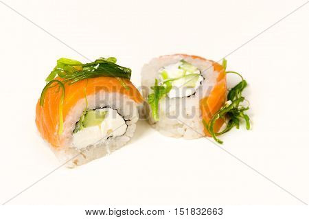 two rolls with seaweed close up isolated on white