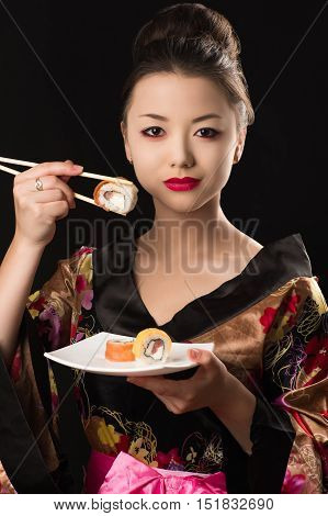 charming Korean girl with dish sushi rolls