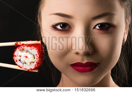 beautiful face young Korean girl with roll, bright makeup